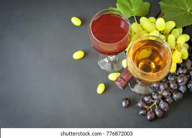 Wine in glasses, grapes branches and leaves with copyspace