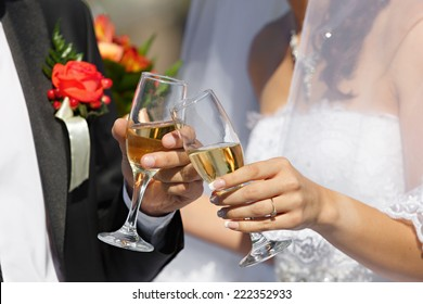 wine glasses in hand bride and groom