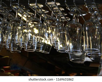 Wine glasses hanging over a bar in small alpine village of Chatel, France