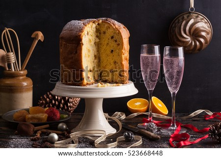 wine glasses and italian typical christmas cake called panettone on a table with christmas - Italian Christmas Table Decorations