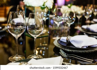 Wine glasses on dining table. Gala banquet table setting with glasses for wine champagne