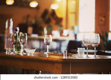 Wine glasses on a restaurant table, selective focus.