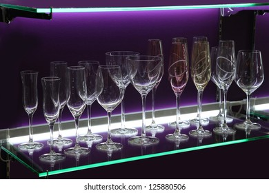 Wine Glasses on the Shelf with Violet Illumination