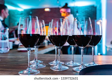 Wine glasses on white background in bright lights