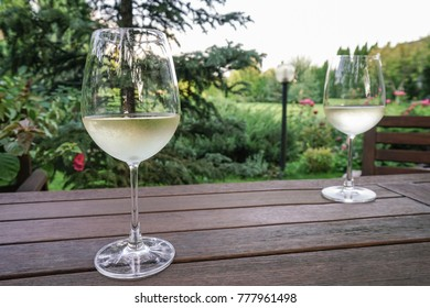 wine glasses on wooden table at garden
