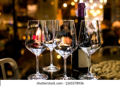 Wine glasses, out of focus in night