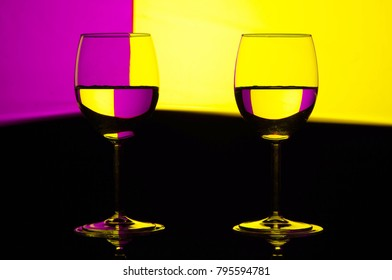 wine glasses over colorful background