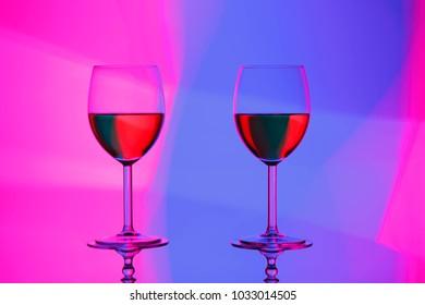 wine glasses over gradient background