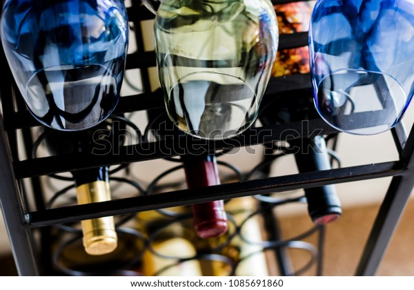 Wine Glasses, Rack, and Bottles
