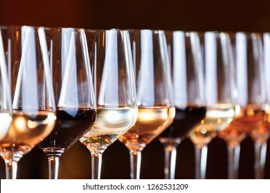 Wine glasses in a row. Buffet table celebration of wine tasting. Nightlife, celebration and entertainment concept. Horizontal