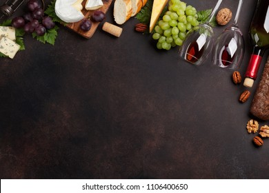 Wine, grape, nuts, bread and cheese. Top view with space for your text