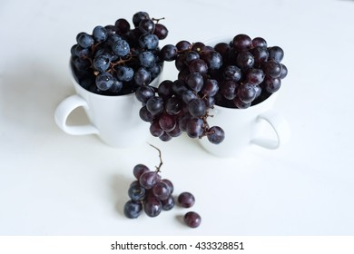 Wine grapes on cups