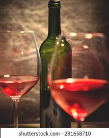 Wine in green bottle glasses. instagram image filter retro style