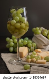 wine with green fresh grape and cheese