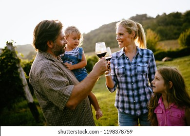 Wine grower family in vineyard