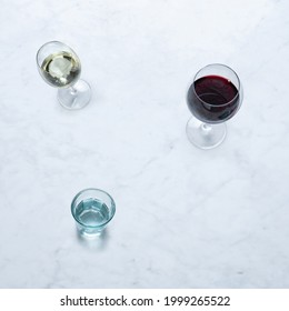 Wine from Italy, Isolated on Marble Background – Glasses of Italian Vino Rosso e Bianco, Red and White Wine, Shot Glass, Goblet Chalice Glass – Close-Up Macro, Top View - Shutterstock ID 1999265522