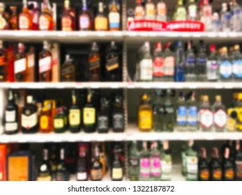 Wine Liquor bottle on shelf with Blurred background