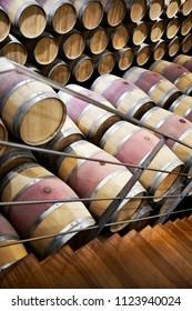Wine oak barrels in a cellar of a French winery