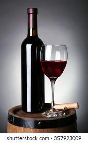 Wine on barrel on dark background