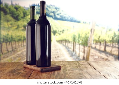 wine on a wooden board and vineyard