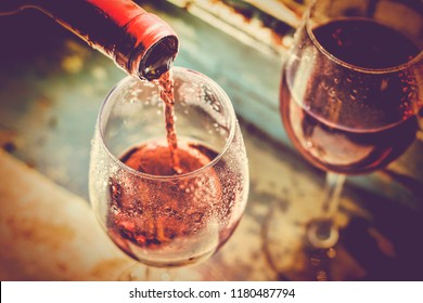 wine is poured into glass. Wine tasting, restaurant, St. Valentine's Day, winemaking