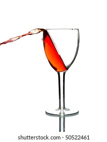 wine pouring out of glass isolated on white