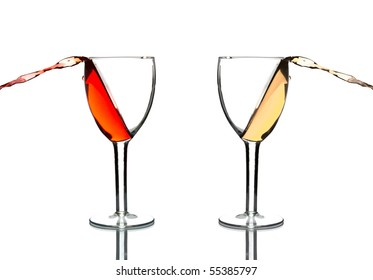 wine pouring out of glasses isolated on white