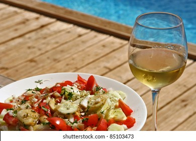wine and salad at pool