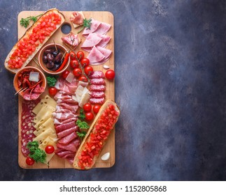 Wine set appetizers on wooden board, copy space