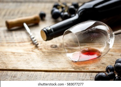 Wine set with bottle and grape on wooden desk