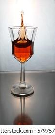 wine splashing in a glass