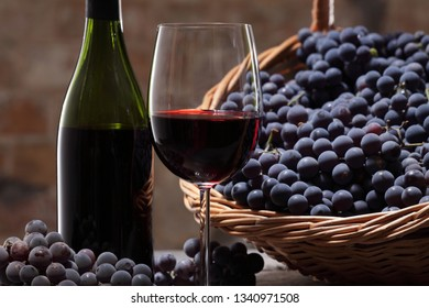 Wine still life / red wine grapes basket  /  red wine glass and bottle