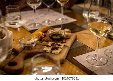 Wine tasting with cheese, bread and oil. Photo taken in Budapest, Hungary.