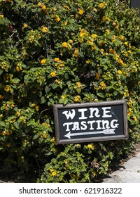 A wine tasting sign points the way.