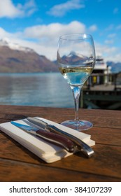 Wine and utensils for outdoor dining in breathtaking landscape