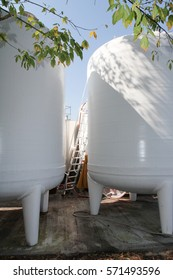 wine vats are outdoors for winemaking