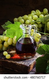 Wine vinegar in a jug. Still life in the rustic style. Selective focus.