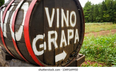 Wine Vino Grapa Sign on Wooden oak Barrel to vineyard in Croatia
