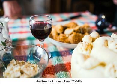 Wine, Wheat Grain and Slava Bread on the table