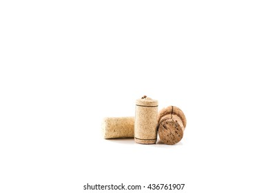 Wine wooden cork on white background. From alcohol beverage. Vintage brown winery object. Natural texture. Wood stopper collection.