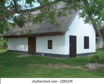 wine-cellar from hungary. this place is a little old wine-country. old mud-hut (made of adobe) buildings with thatched roof!