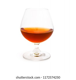 Wineglass with cognac or brandy isolated on white background