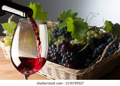 wineglass with grapes in the basket
