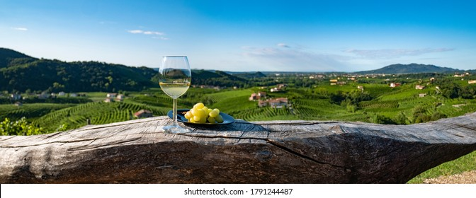 Wineglass With Grapes on a Wood Table, Italian Wine, Glass of White Wine
