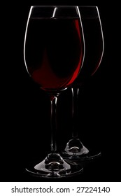 Wineglass with red wine isolated on a black background