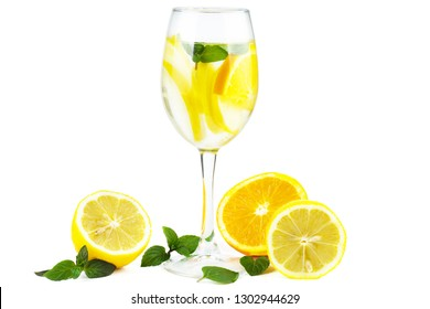Wineglass with water (or alcohol), lemon slices and mint isolated on white background