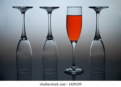 Wineglasses with colored liquid illustrating the concept of possitive thinking.