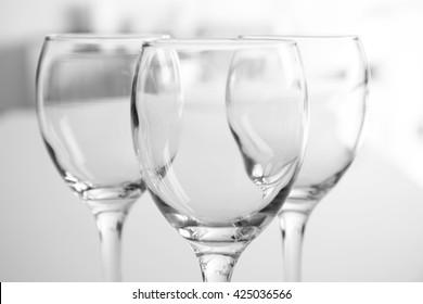 Wineglasses on blurred interior background