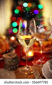 Wineglasses on a Christmas table setting, close up