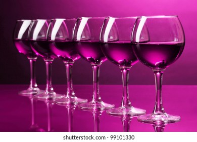 Wineglasses on pink background